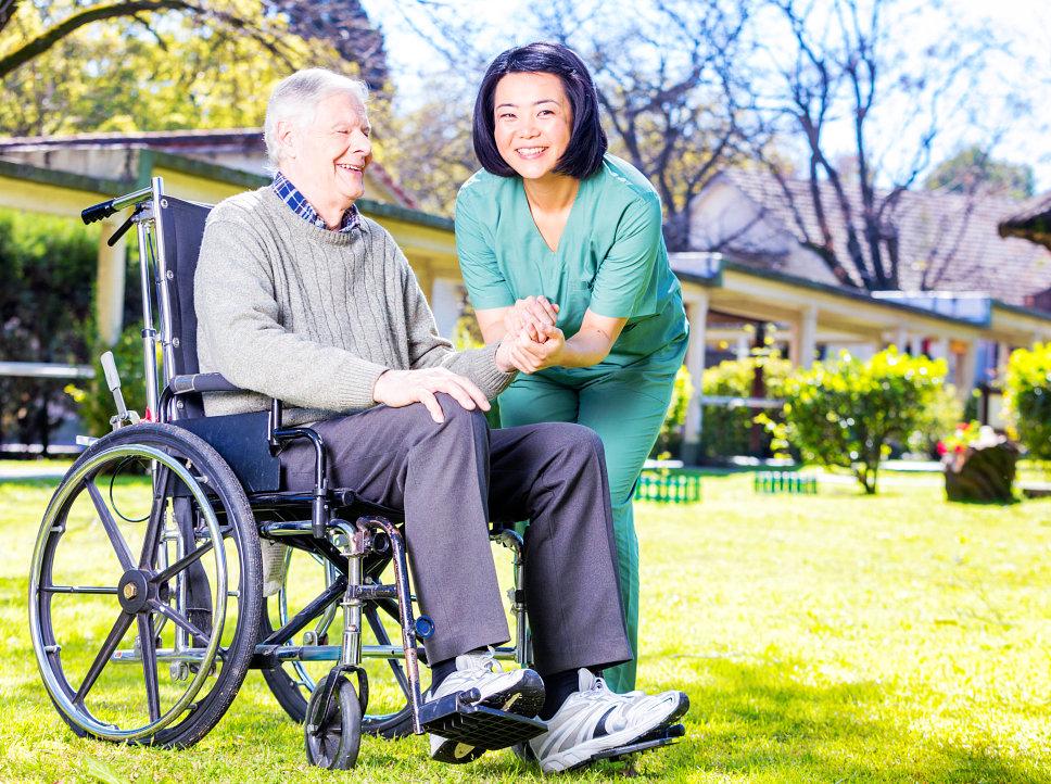 elder in a wheelchair with caregiver