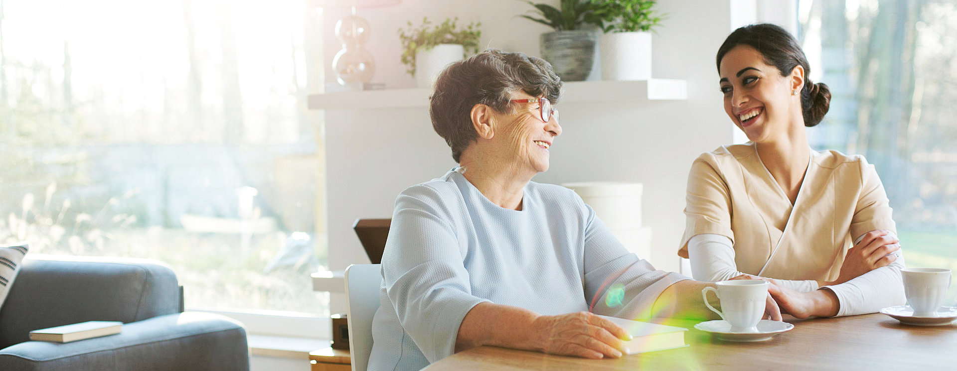 elder woman with caregiver looking at each other
